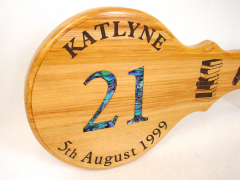Rimu 21st key, the 21 has been inlaid with Pāua the rest of the text, and books, are laser engraved.