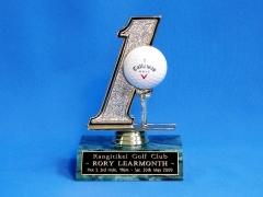 Rory's hole in one trophy.